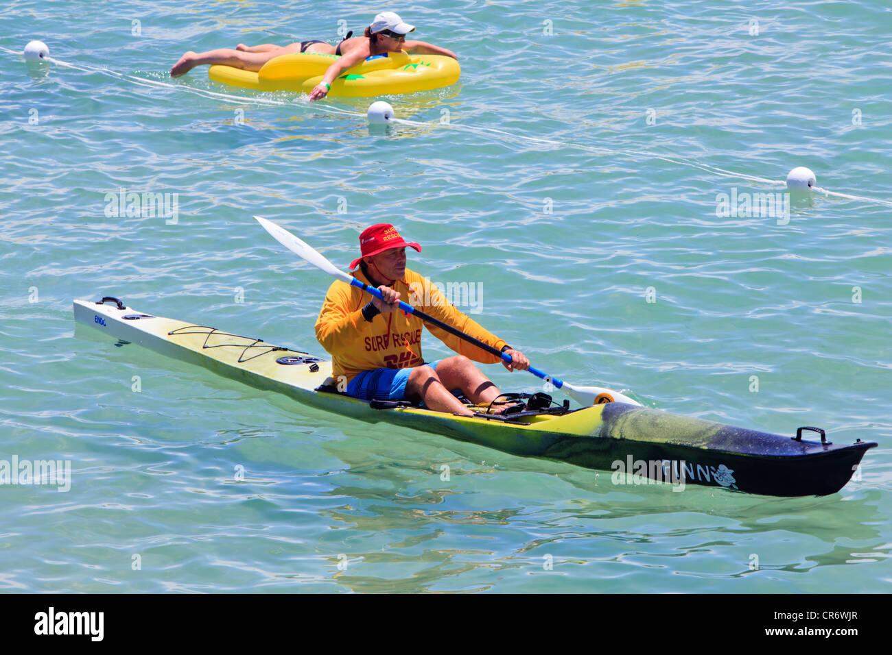 Surf Life Saver in a kayak at Cottesloe Beach in Perth, Western Australia - Stock Image