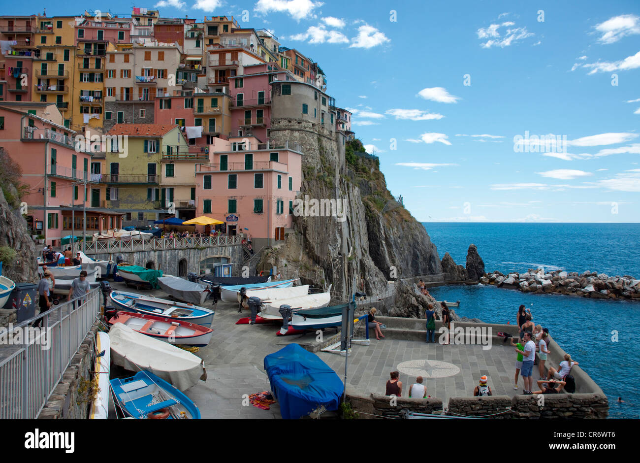 Due to lack of space in the port, the fishing boats are parked on rolls, port of the fishing village , Cinque Terre, - Stock Image