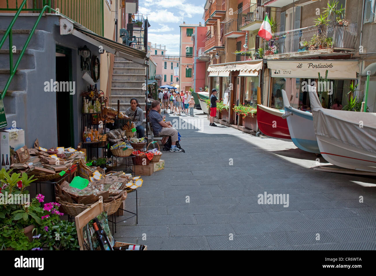 Alley with parked fishing boats due to lack of space in the harbour, fishing village of , Cinque Terre, La Spezia - Stock Image