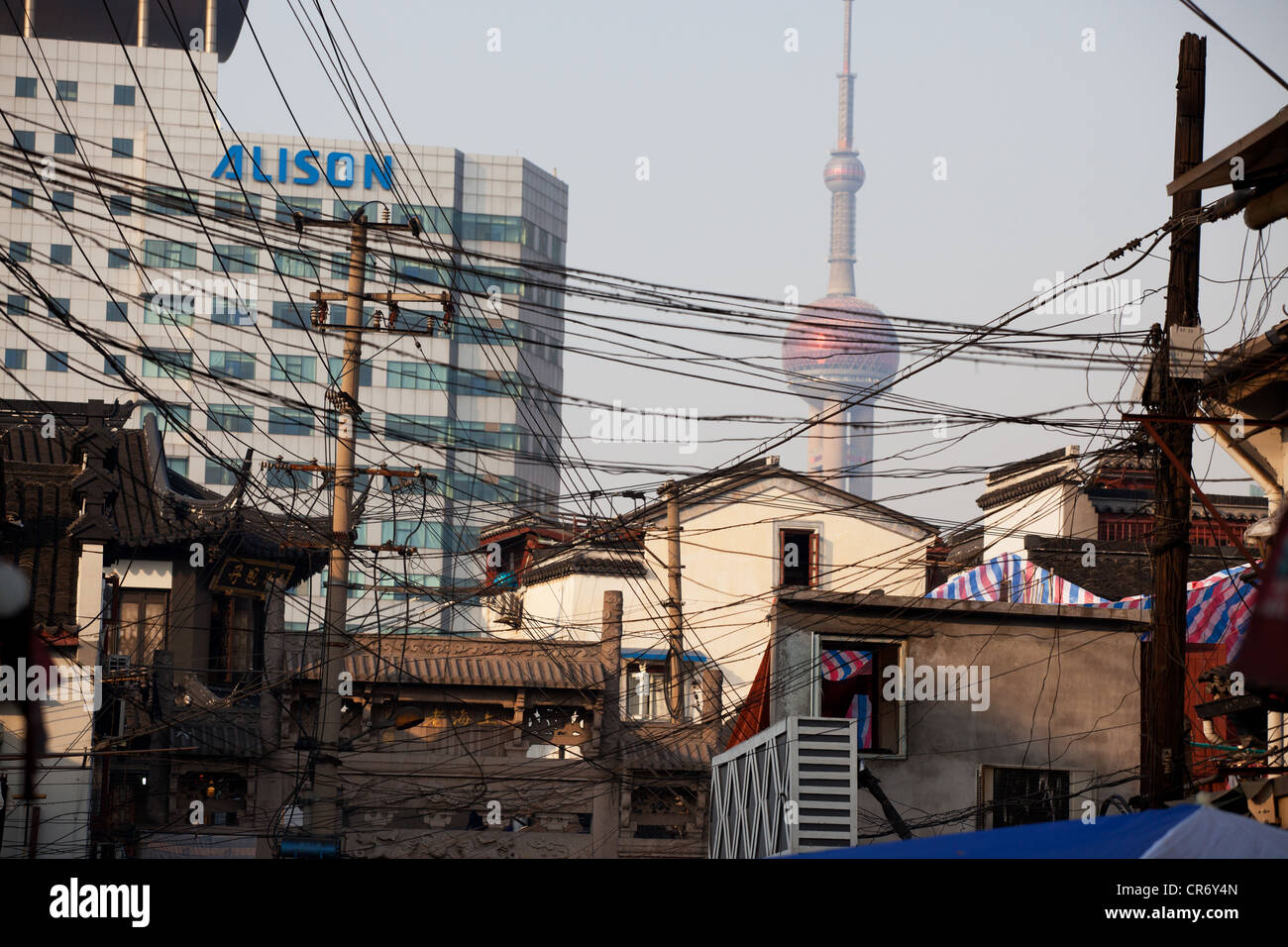 China Shanghai view of electrical cables and houses with pearl tower ...