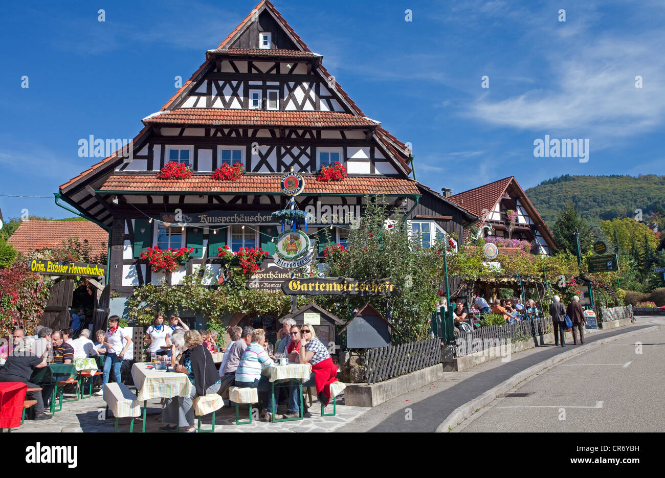 Guests in the garden restaurant of the Knusperhaeuschen, , North Black forest, Black forest, Baden-Wuerttemberg - Stock Image