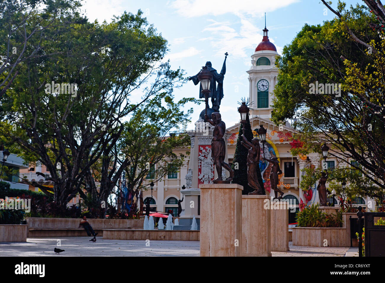 Low Angle View of Plaza Colon with the City Hall and the Statue of Christopher Columbus, Mayaguez, Puerto Rico - Stock Image