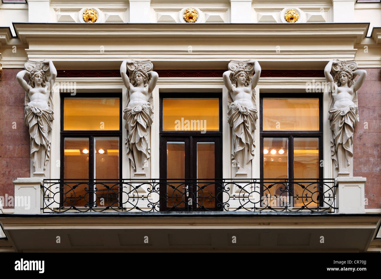 Four carriatides on a balcony of a wealthy middle-class home, 19th Century, Kaerntnerstrasse 5, Vienna, Austria, - Stock Image