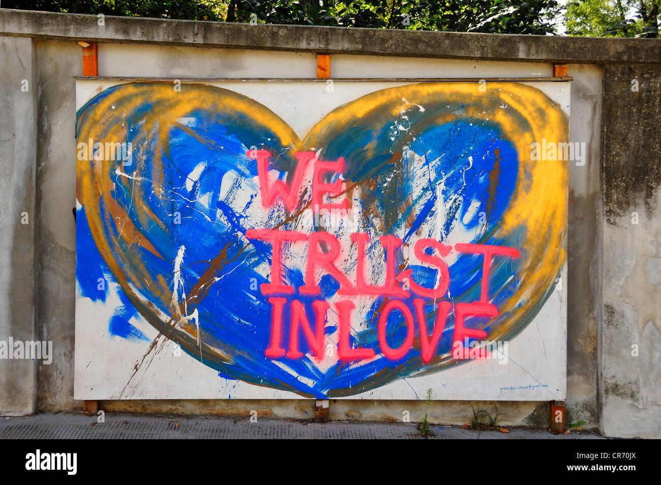 Billboard with graffiti slogan we trust in love argentinierstrasse vienna austria