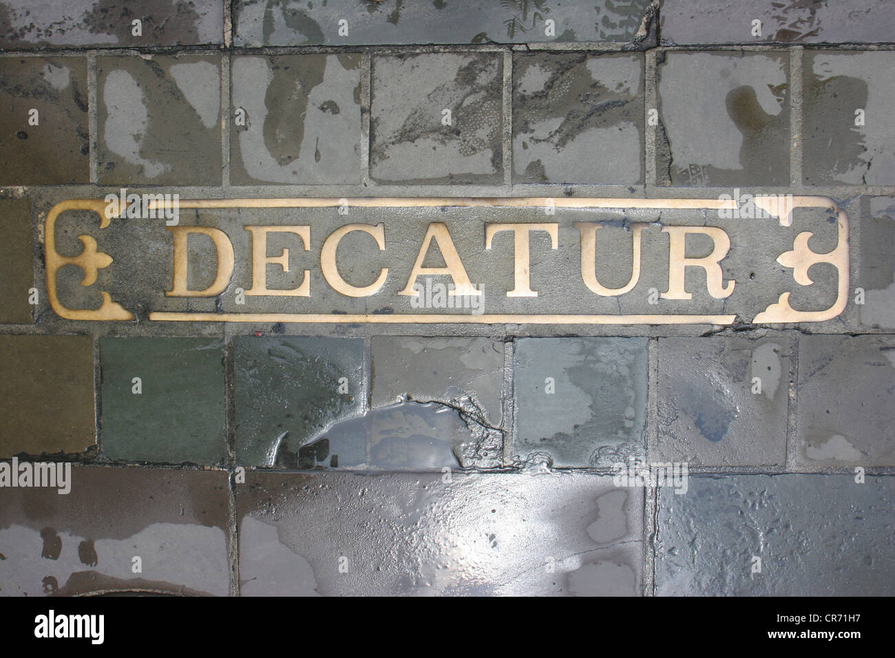 The street name on the pavement of Decatur Street, home of some of New Orleans' important jazz venues - Stock Image