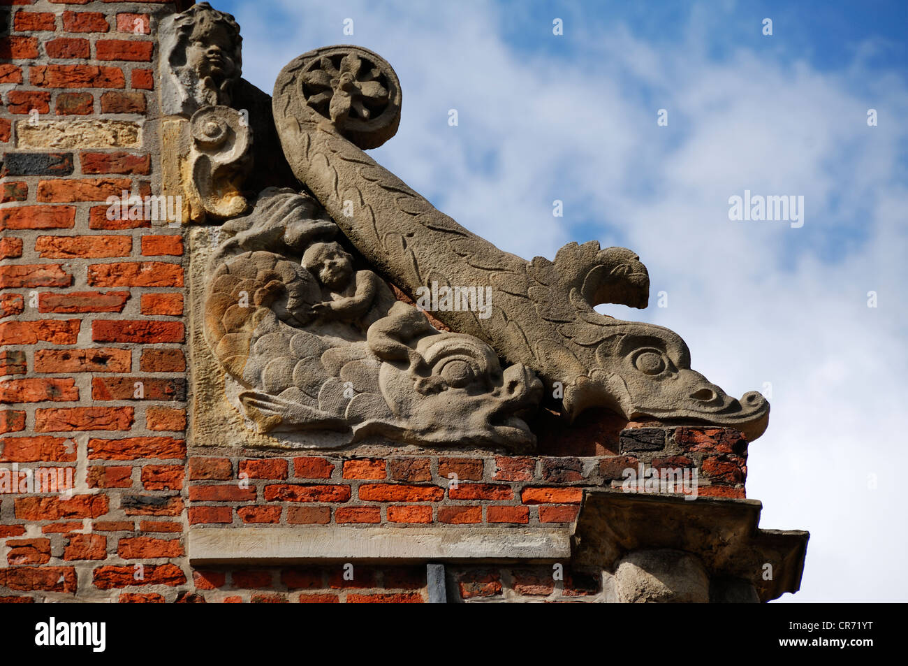 Fish sculptures on the pediment of the patrician Heinrich-Heine-Haus house built between the 15th and 16th century - Stock Image