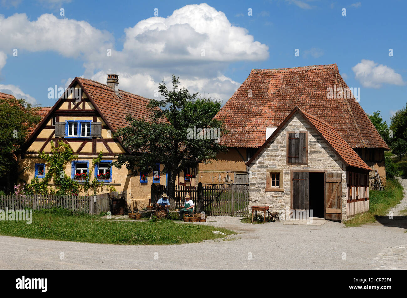 Haeckerhaus building, 1706, left, wheelwright's workshop, 1887, right, barn in the rear, 1590, all from Ergersheim - Stock Image