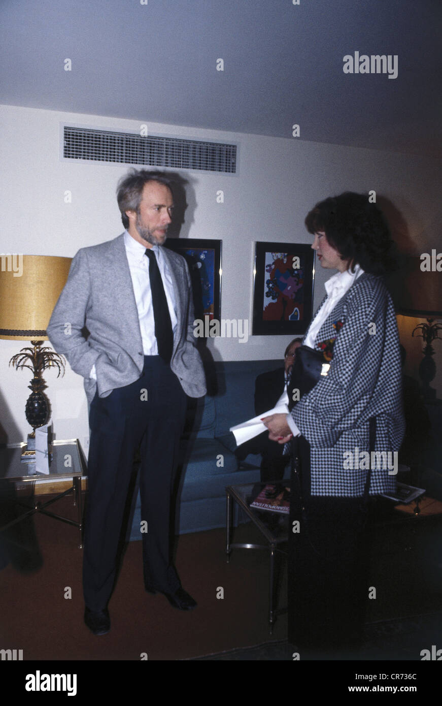 Eastwood, Clint, * 31.5.1930, US actor, full length, in Munich, 1980s, with the German actress Petra Schuermann, - Stock Image