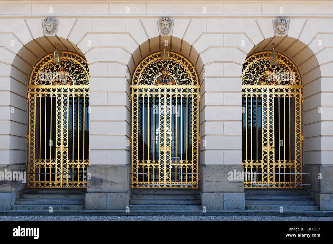 Three gilded gates at the entrance of Herrenchiemsee Palace, Herreninsel island, Bavaria, Germany, Europe - Stock Image