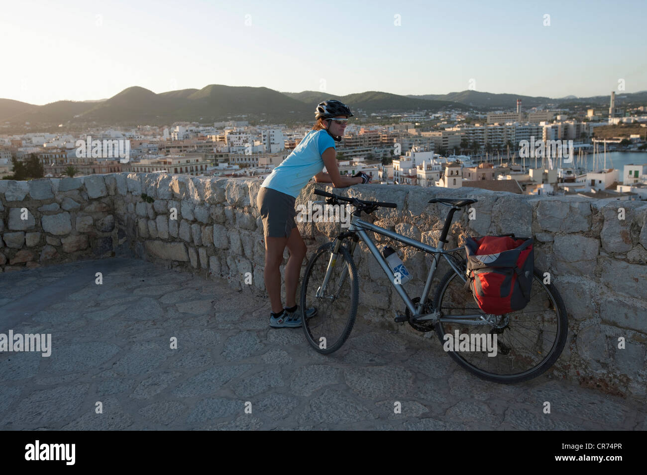 Spain, Ibiza, Eivissa, Mid adult woman with bicycle - Stock Image
