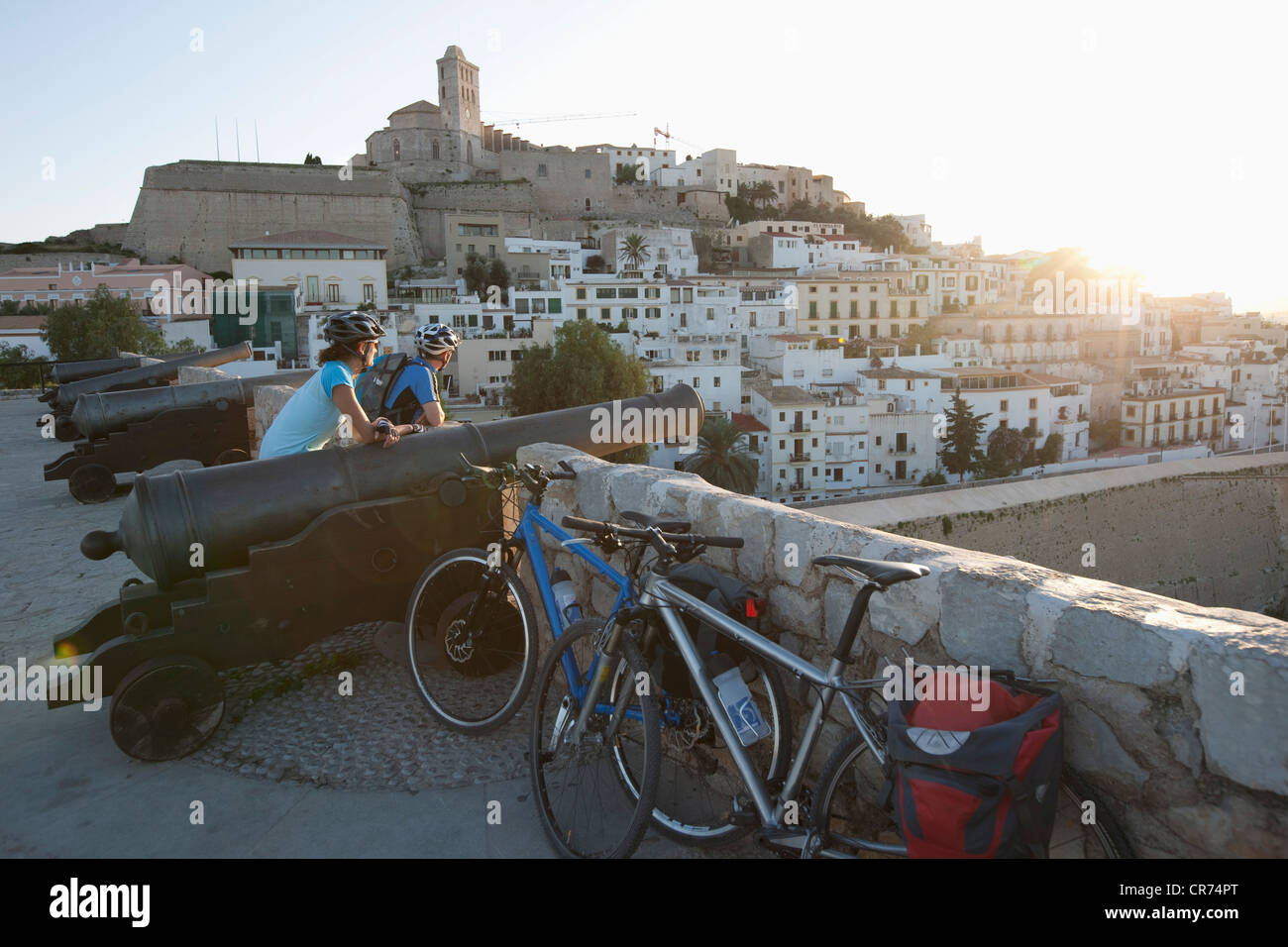 Spain, Ibiza, Eivissa, Mature man and mid adult woman with bicycle - Stock Image