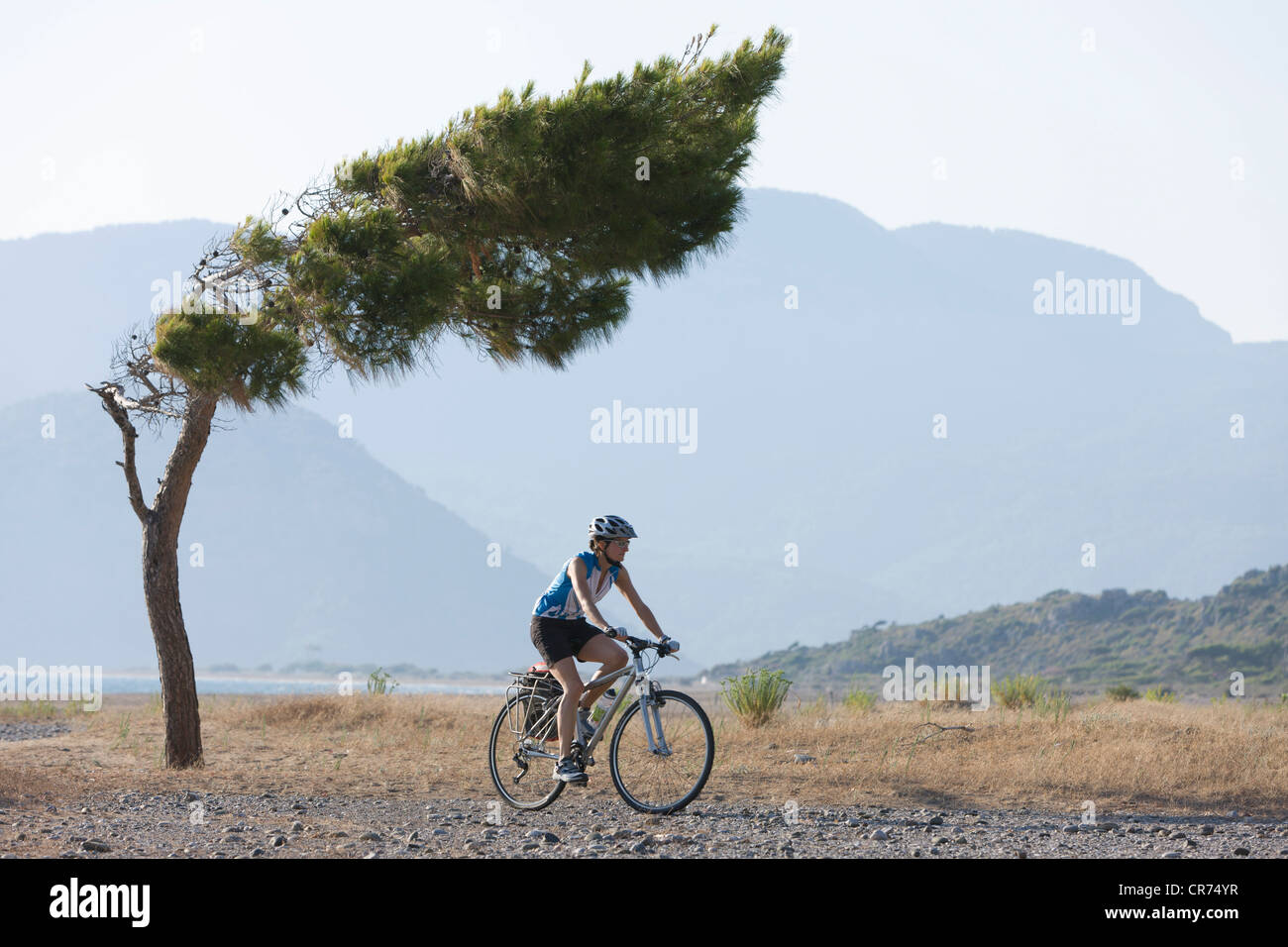 Turkey, Mid adult woman riding bicycle - Stock Image