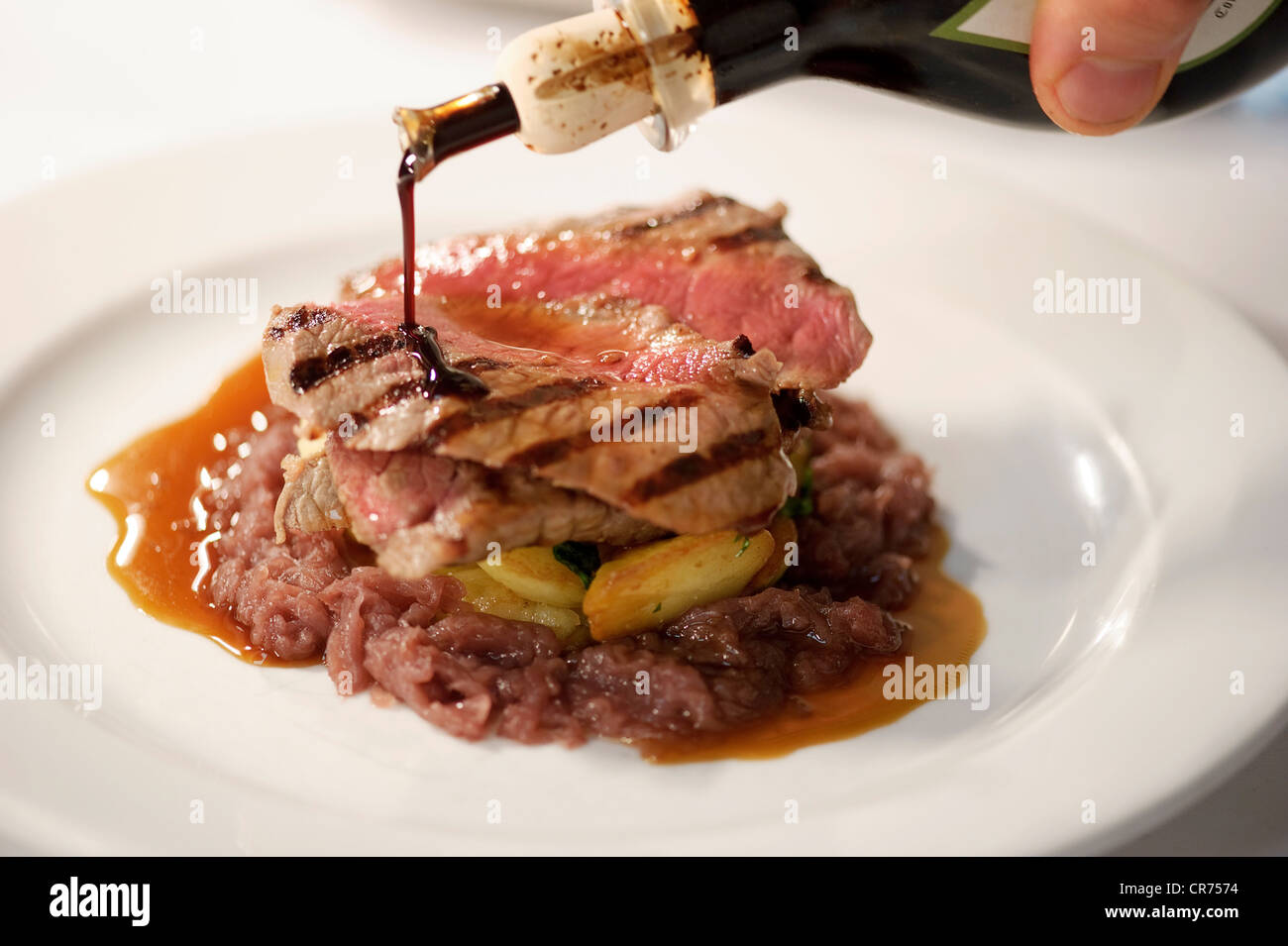 meal being prepared in posh restaurant - Stock Image