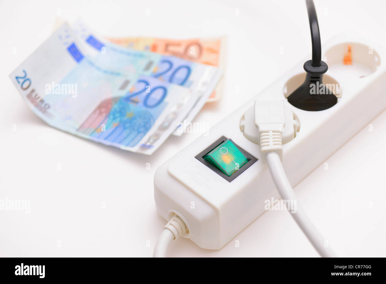 Switchable Multiple Socket Outlet With Euro Banknotes Stock Photo