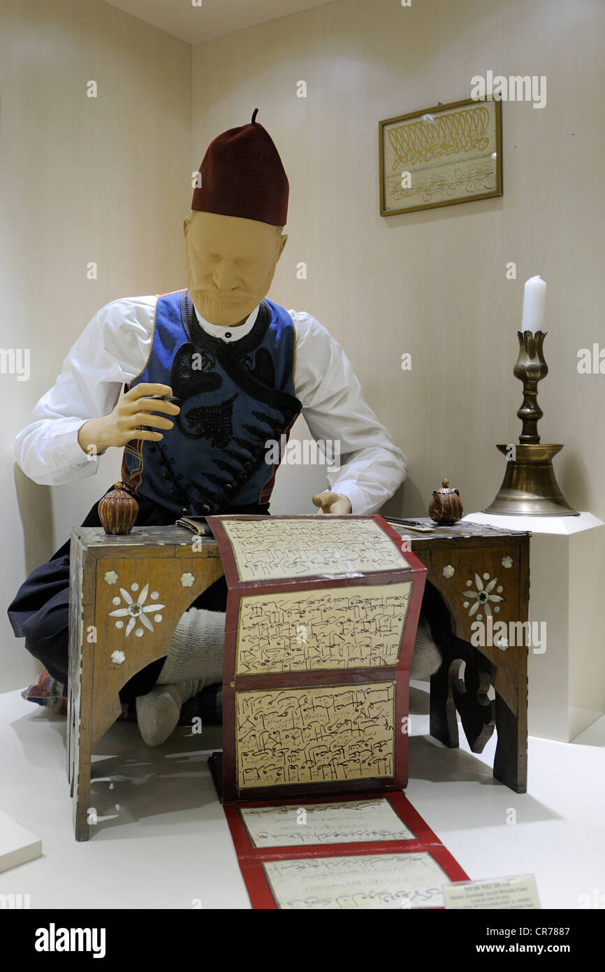 Turkey, Central Anatolia, Ankara, the Ethnographic Museum, calligrapher working on a 19th century Muslim calendar - Stock Image