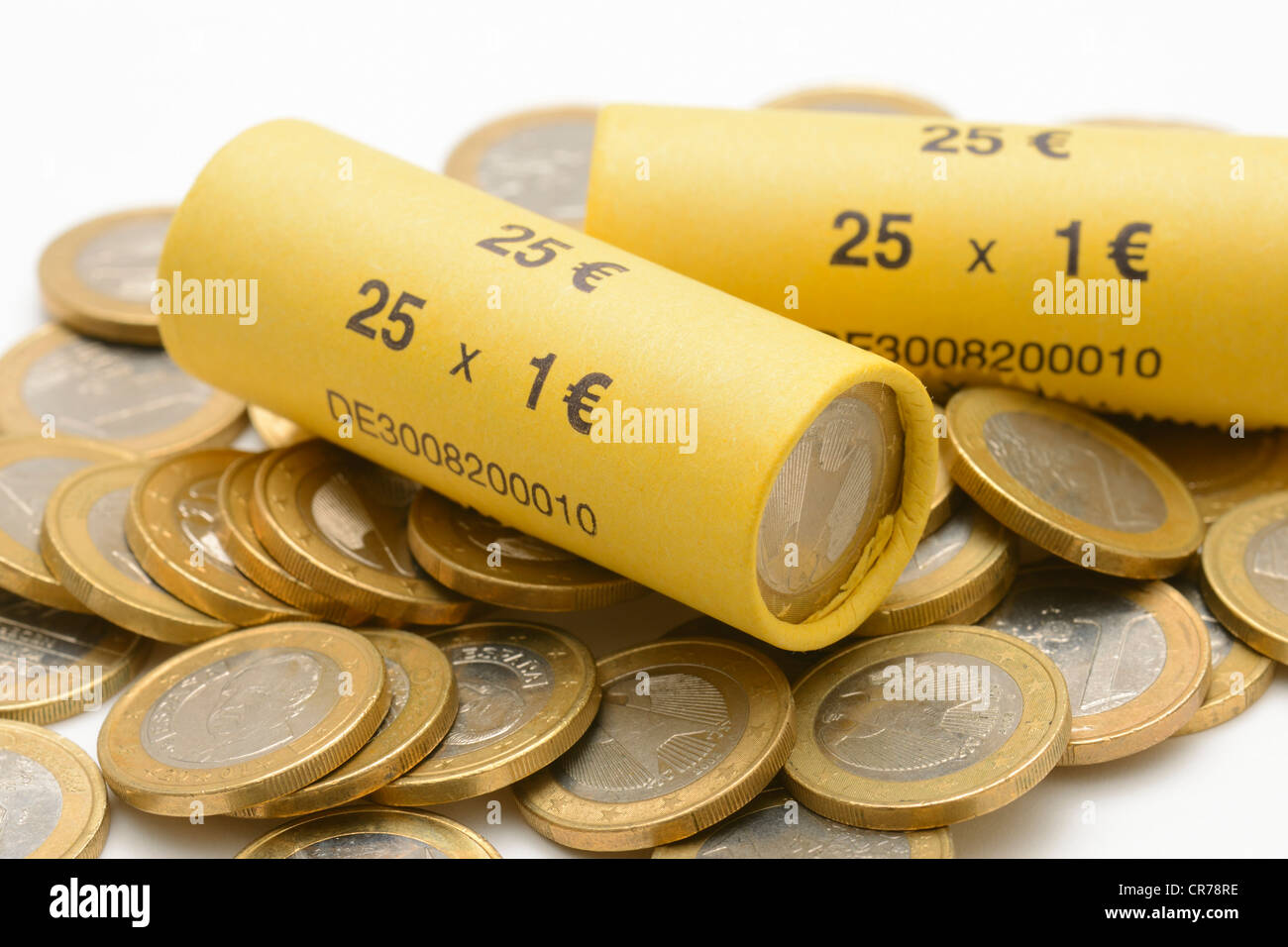1-Euro coins, rolled up and loose coins - Stock Image