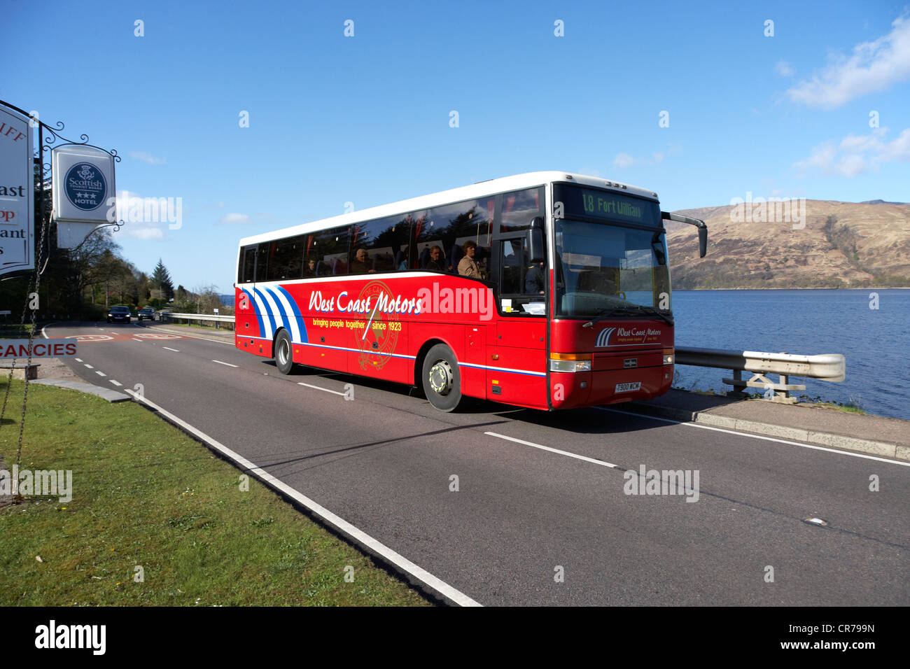 west coast motors bus coach on the main a82 tourist route road along the shores of loch linnhe near fort william - Stock Image