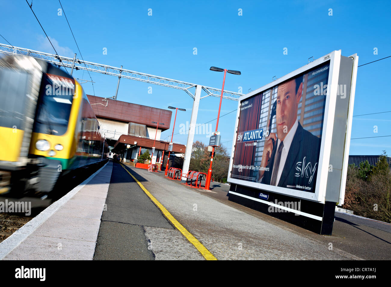 Outdoor advertising billboard panel at Birmingham International railway station. Creative shows ad for Sky HD Atlantic - Stock Image