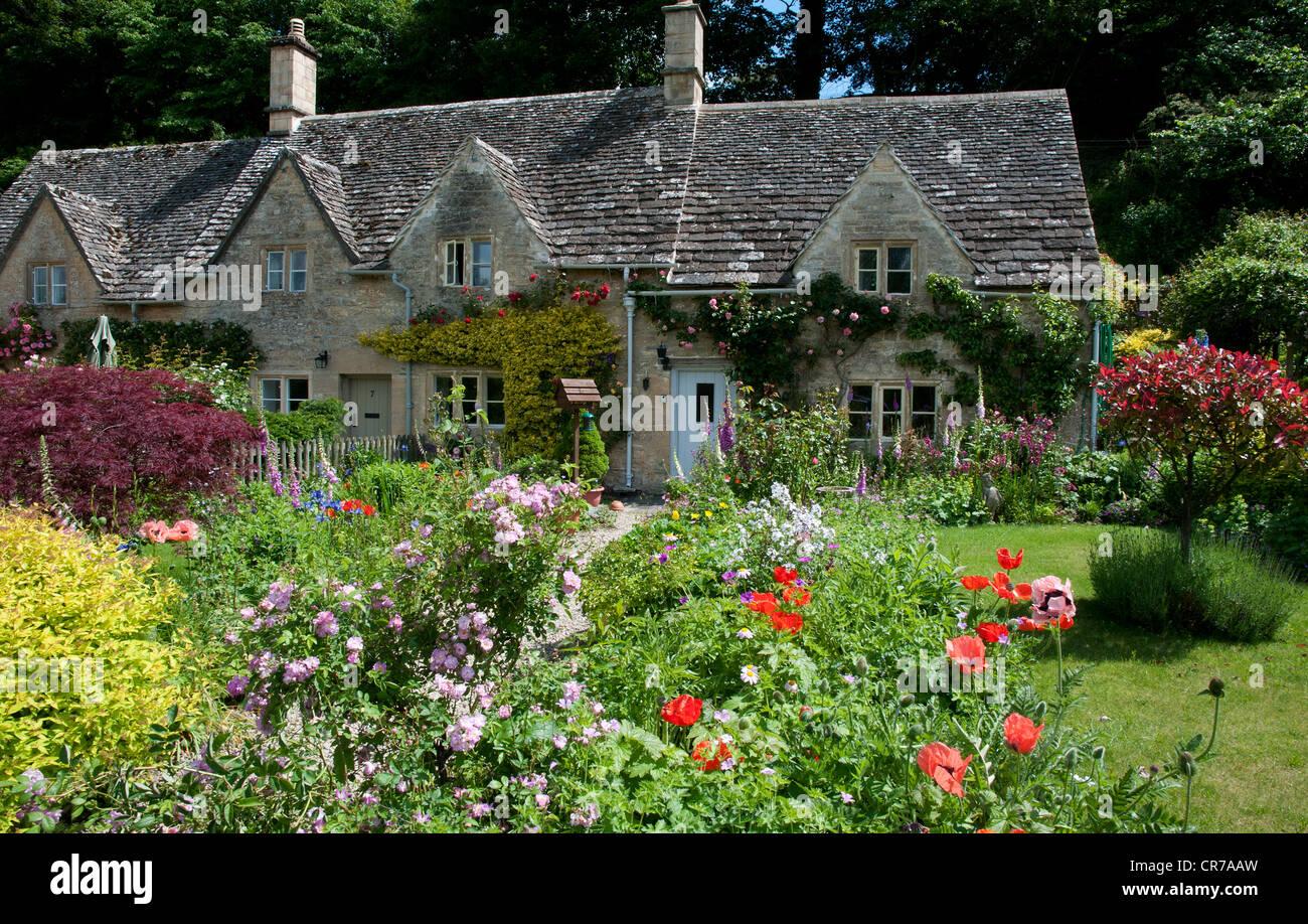 English cottage garden Bibury Gloucestershire England UK - Stock Image