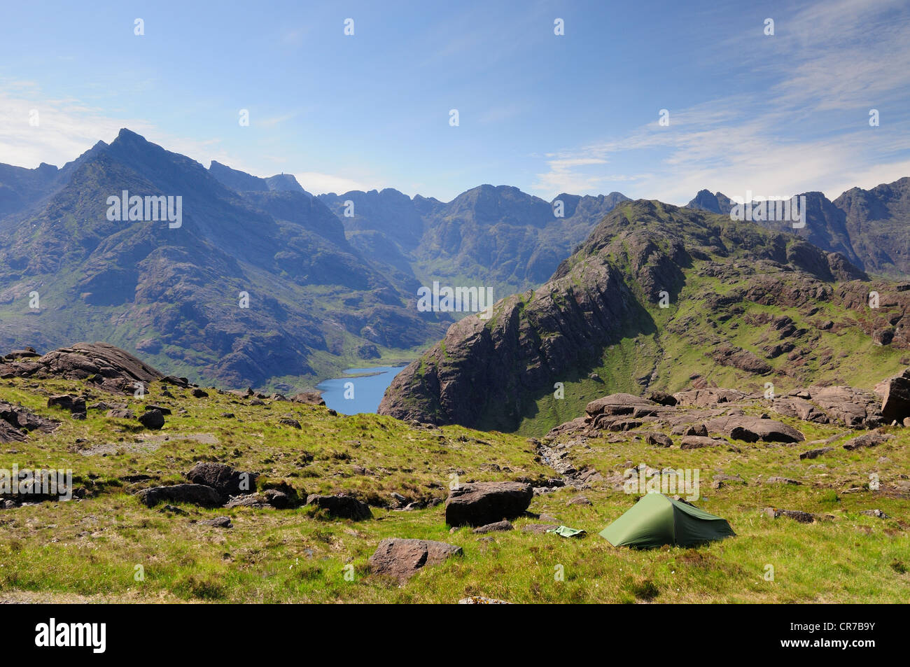Wild camping on the Isle of Skye, with Loch Coruisk and the jagged Black Cuillin ridge in the background - Stock Image