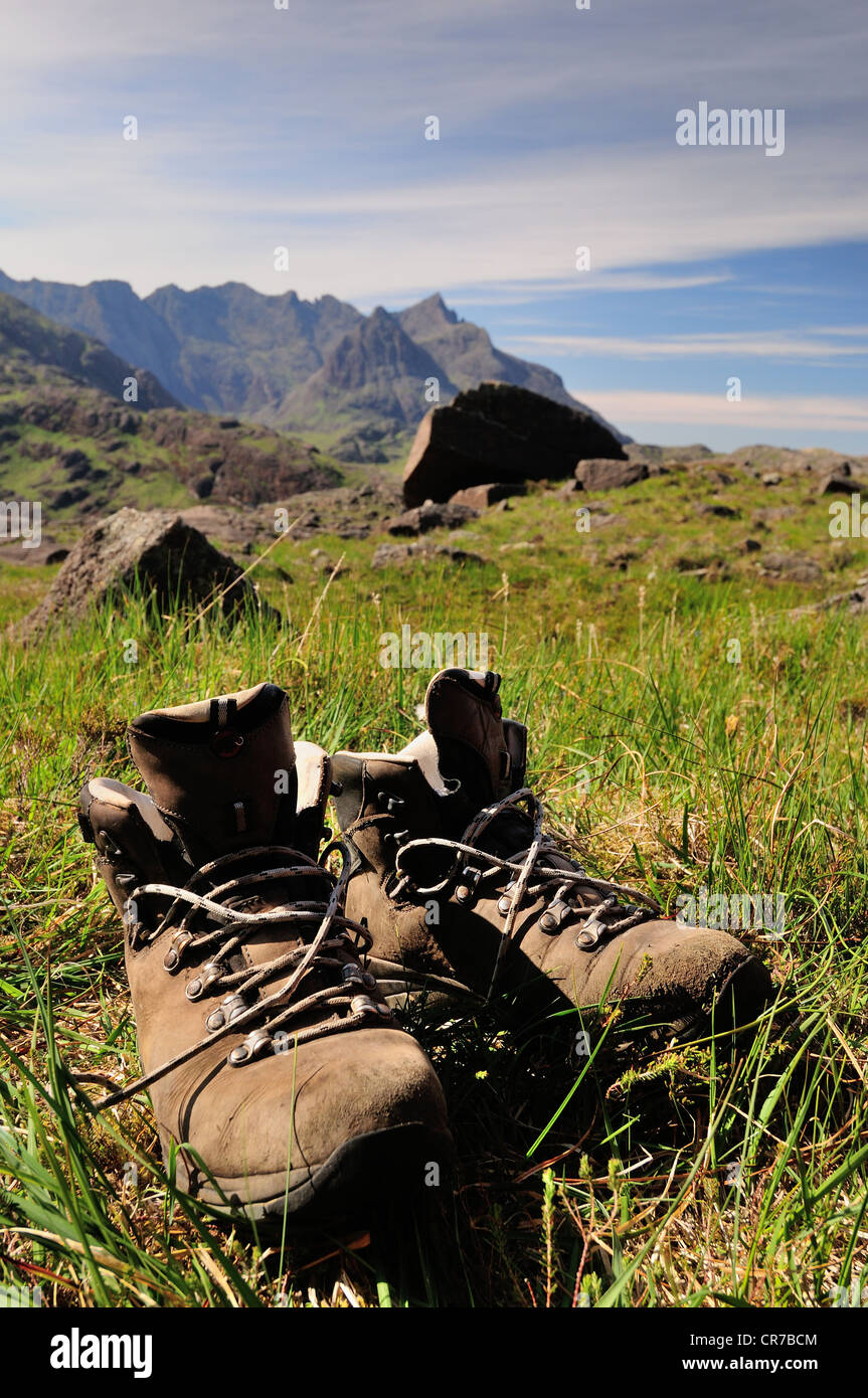 Walking boots airing outside a tent. Wild camping view on the Isle of Skye - Stock Image