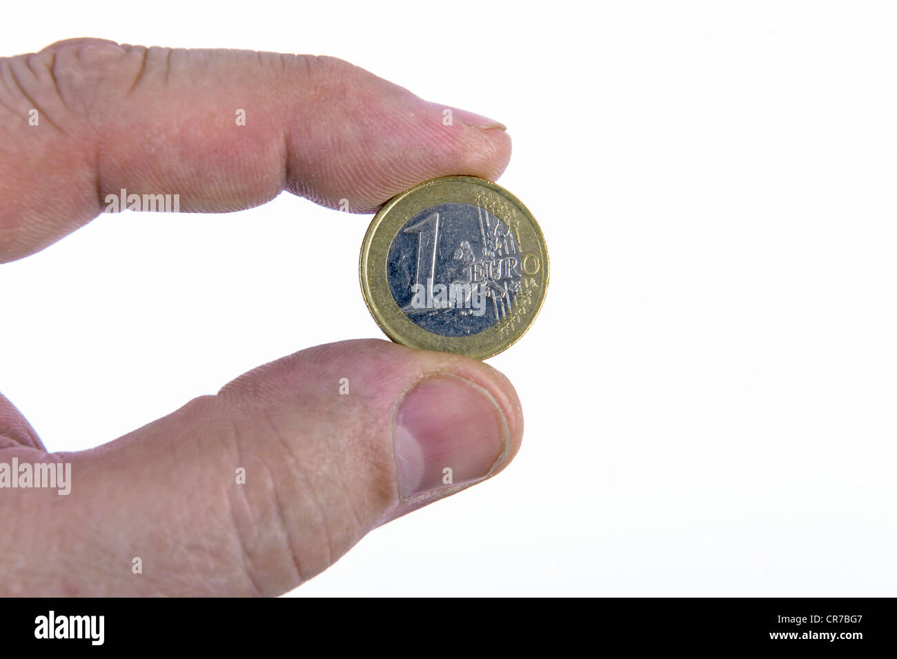 Fingers of one hand holding a 1 Euro coin - Stock Image