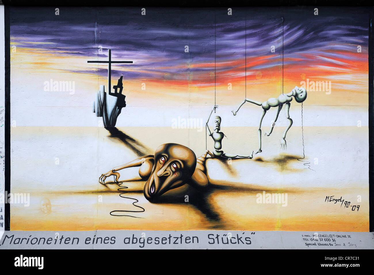 Marionetten eines abgesetzten Stuecks, Puppets of a cancelled play, by Marc Engel, painting on the Berlin Wall - Stock Image