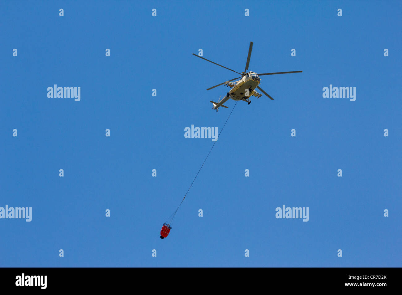Egyptian military helicopter towing firefighting bucket - Stock Image