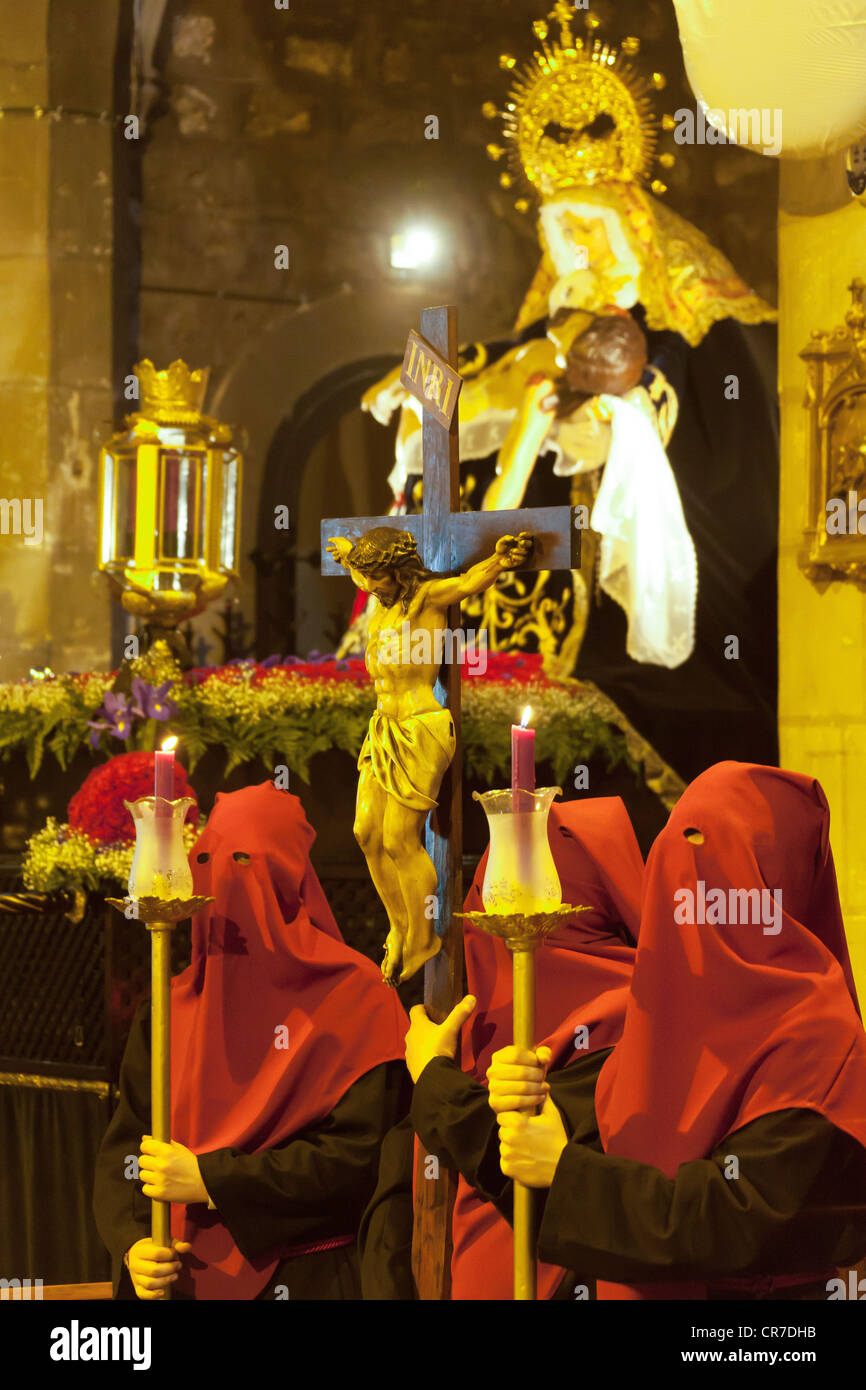 Penitents in a Semana Santa procession, Church of Sant Jaume Cala de Ferran, preparation for the Easter procession, - Stock Image