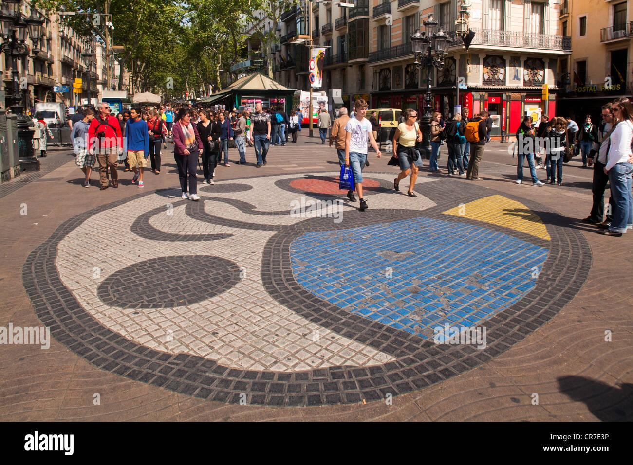 Mosaic by Miro, floor mosaic, tourists, Ramblas, Rambla, Rambles, pedestrian zone, Barcelona, Catalonia, Spain, - Stock Image