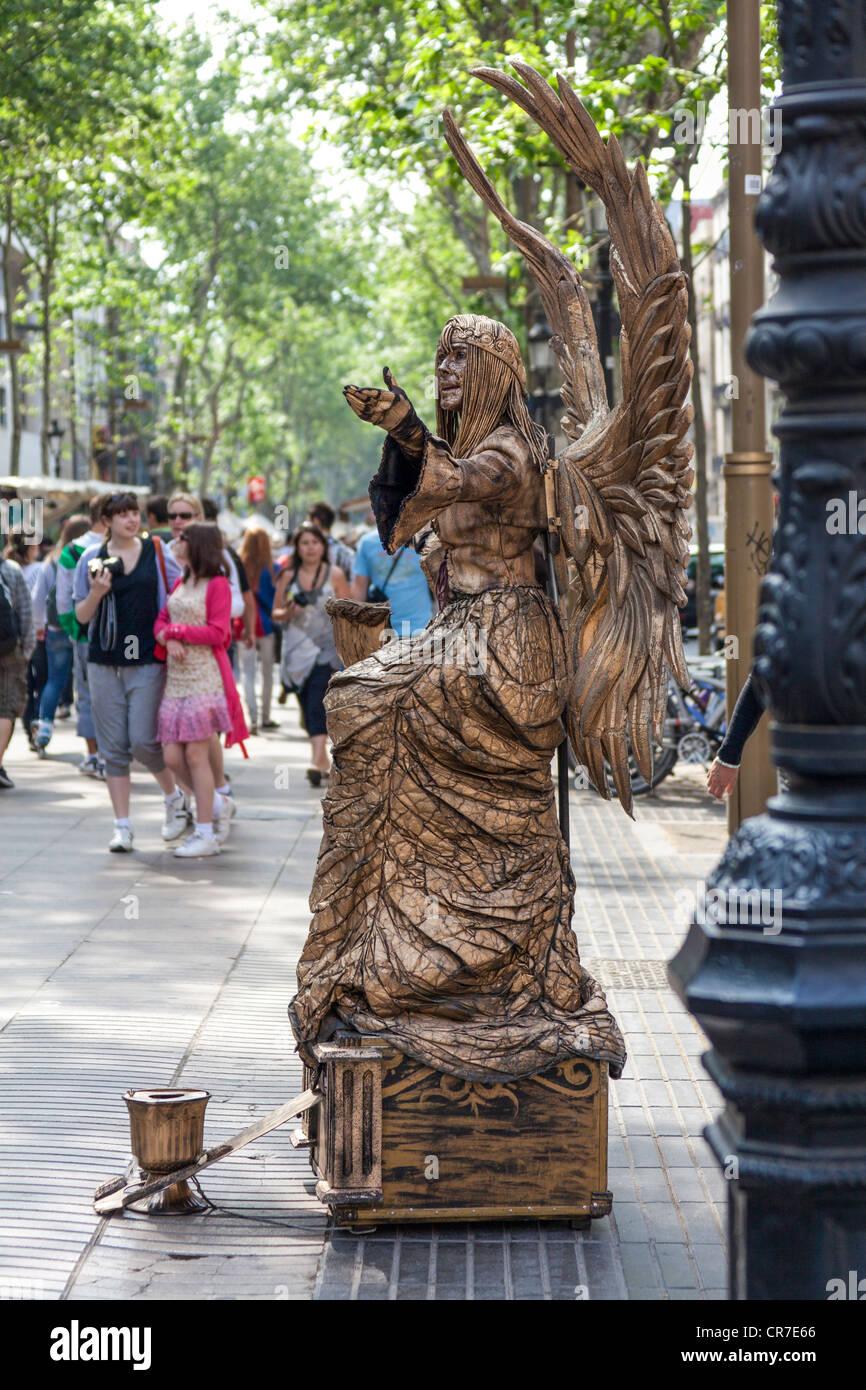 Bronze angel, living statue, Ramblas pedestrian area, Barcelona, Catalonia, Spain, Europe - Stock Image