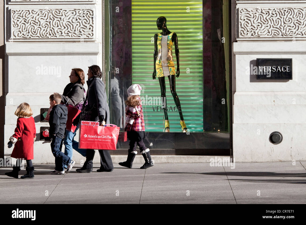 United States, New York City, Manhattan, 5th avenue, Versace boutique, window and pedestrians - Stock Image
