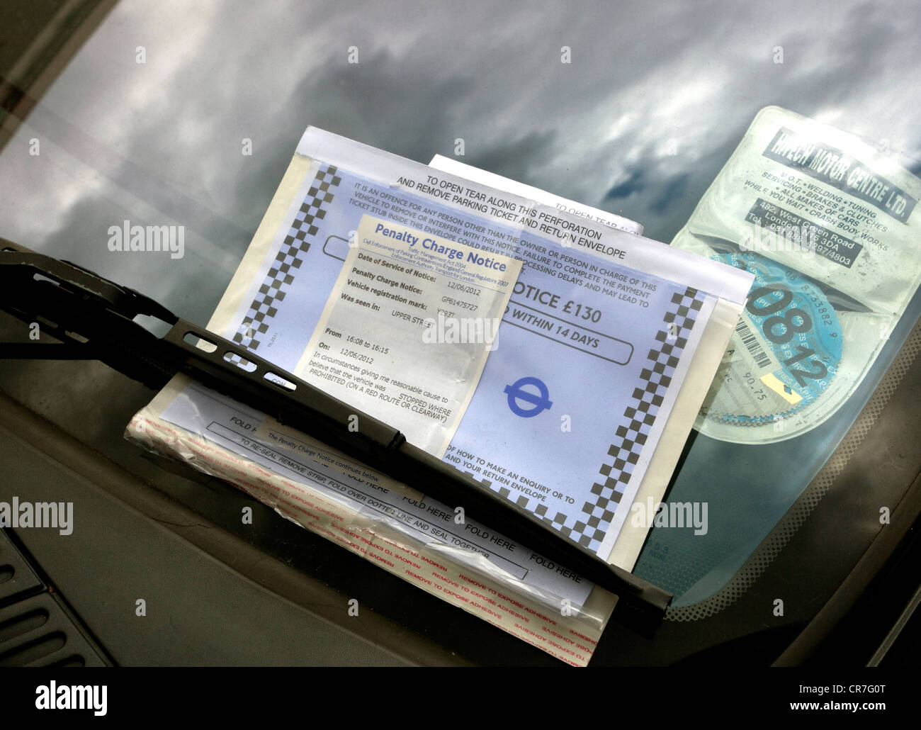 Penalty Charge notice on car left on Red Route, London - Stock Image