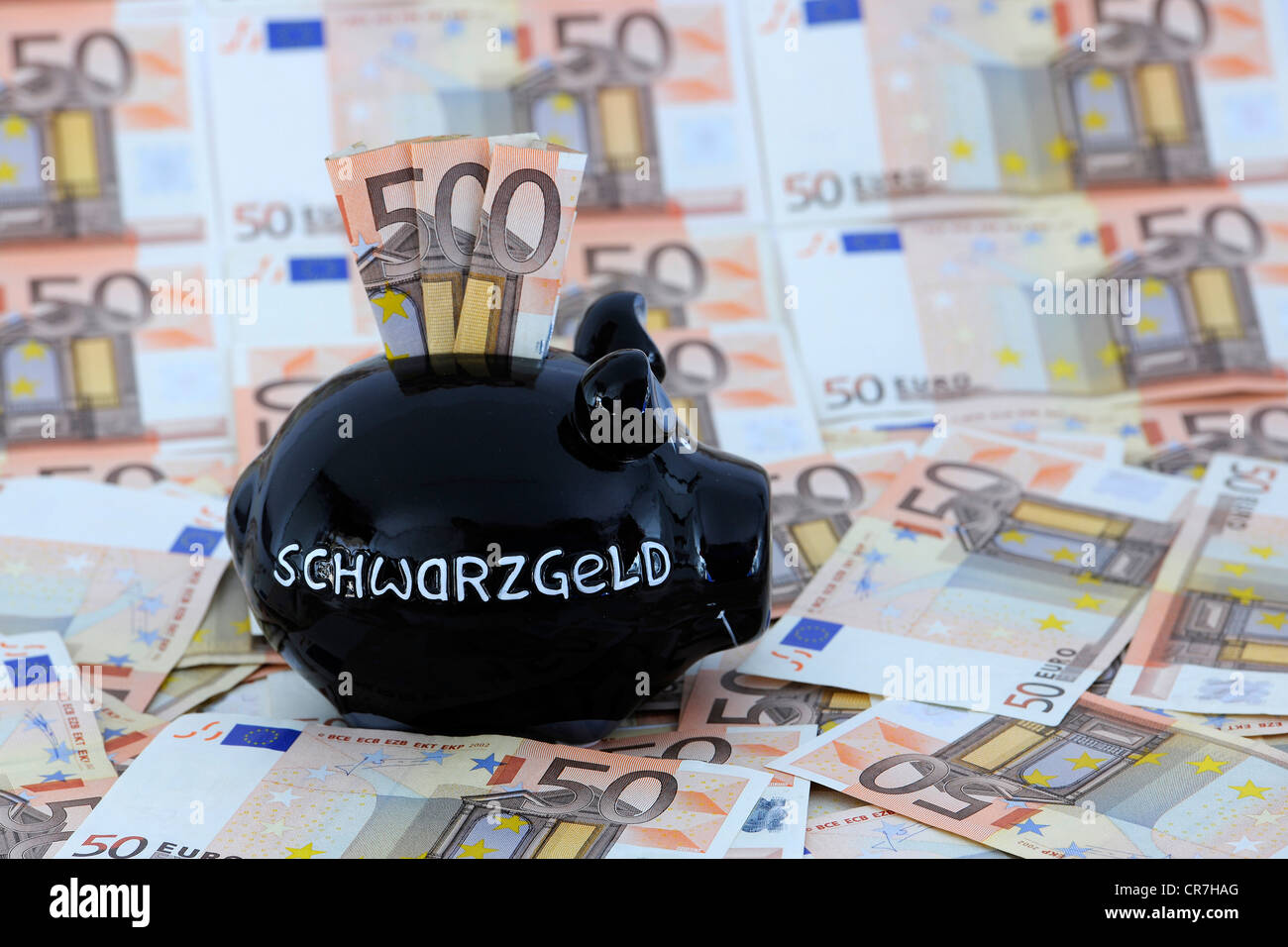 Black piggy bank with Schwarzgeld or dirty money and 50-euro notes - Stock Image