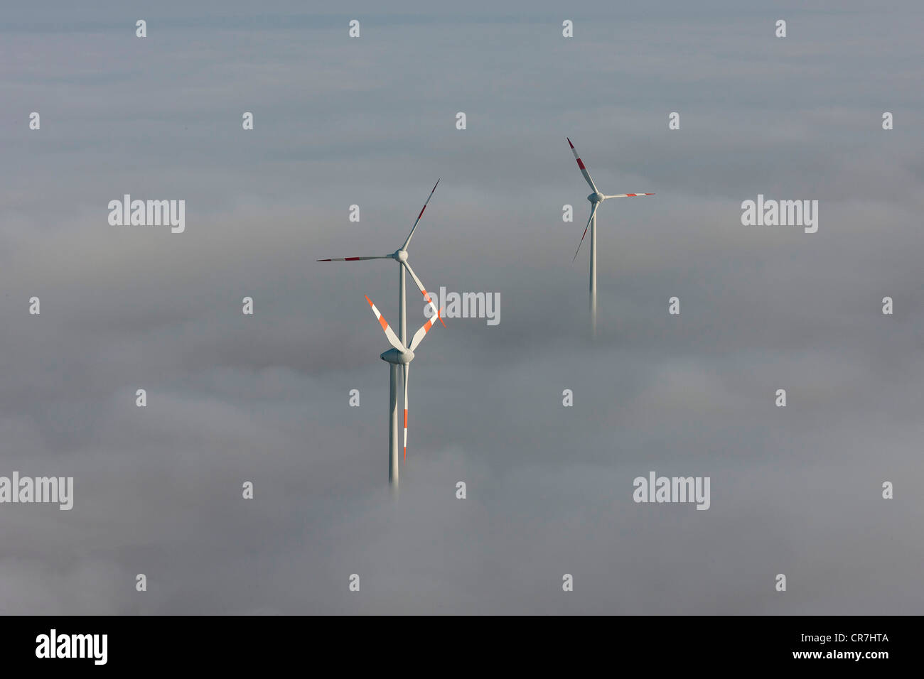 Aerial view, wind turbines sticking out from cloud cover, Heldrungen, Thuringia, Germany, Europe - Stock Image