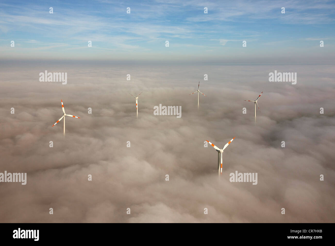 Aerial view, wind turbines sticking out from cloud cover, Kyffhaeuser district, Thuringia, Germany, Europe - Stock Image