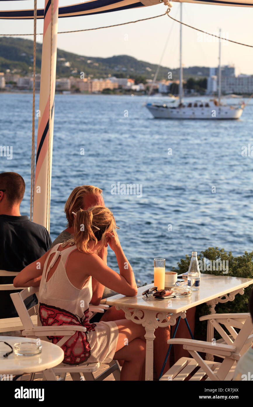 Spain, Balearic Islands, Ibiza, Sant Antoni, People watching sunset at the world famous Cafe del Mar - Stock Image