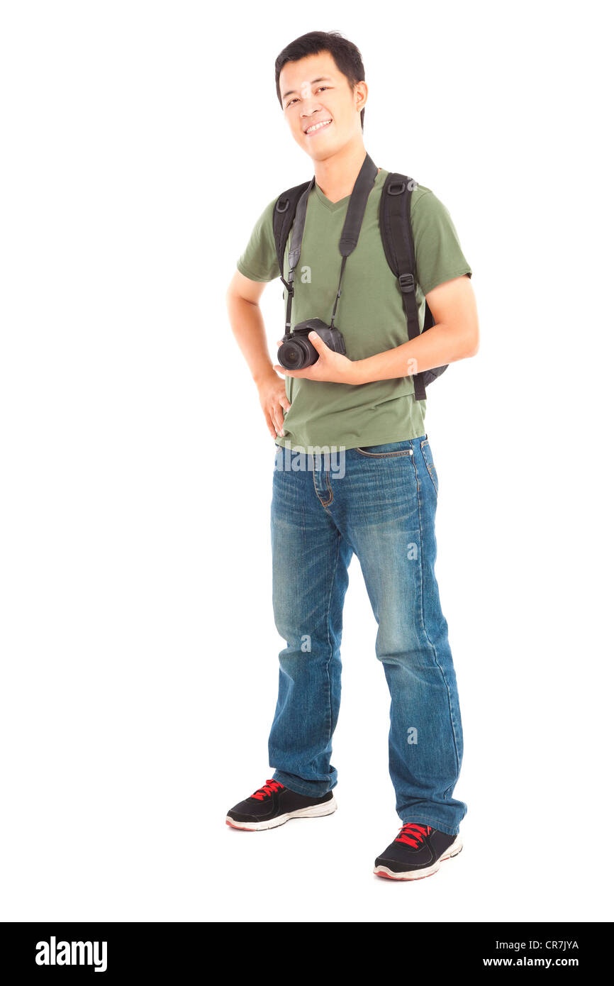 Full length of asian young man with camera Stock Photo