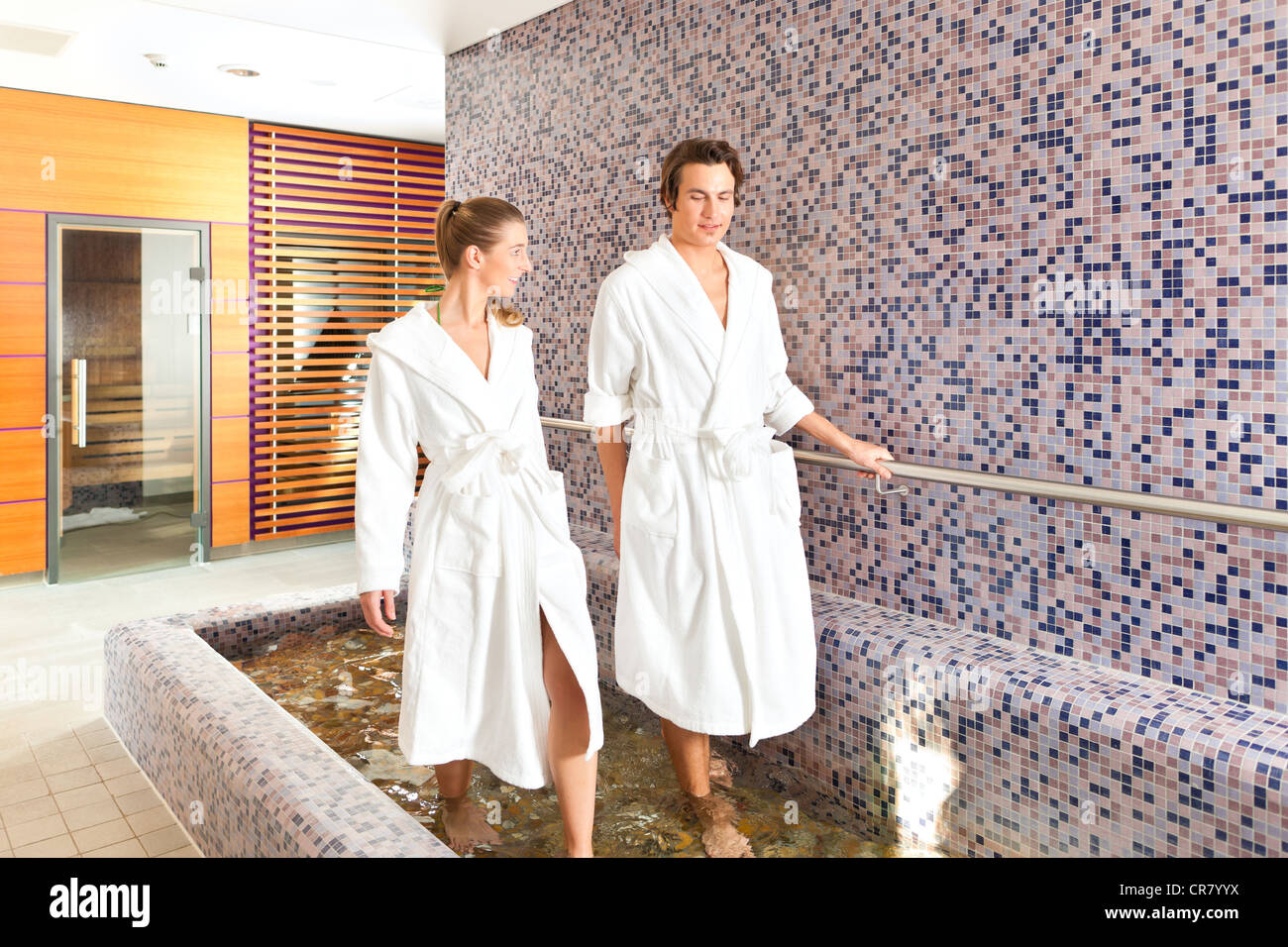 Man and woman while wellness water treading or hydrotherapy - Stock Image