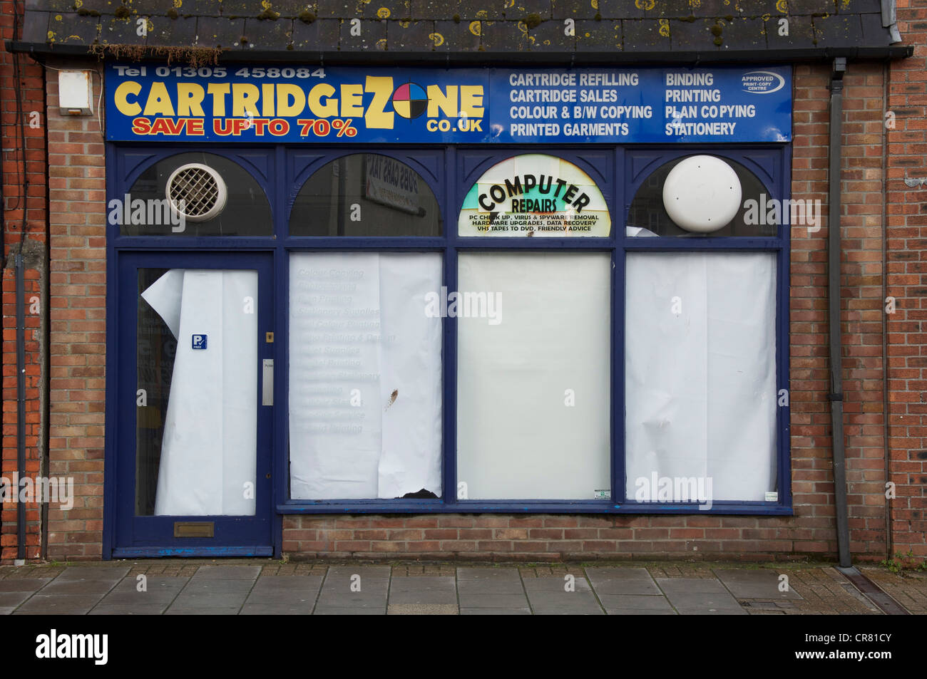A provider of copying and printing services, closed down. Another of the many high street casualties of the global Stock Photo