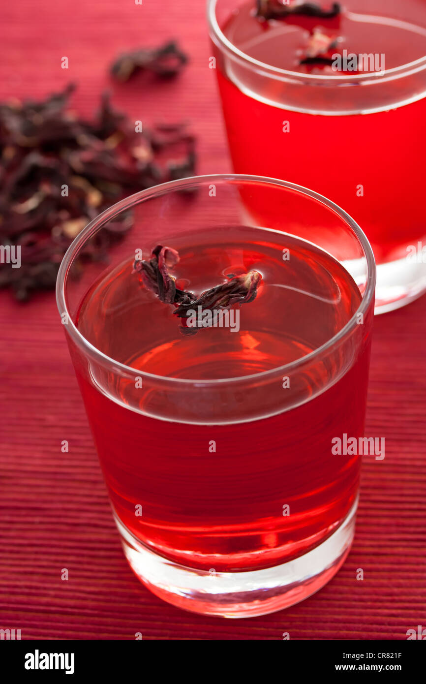 Hibiscus herbal tea in glass cup - Stock Image