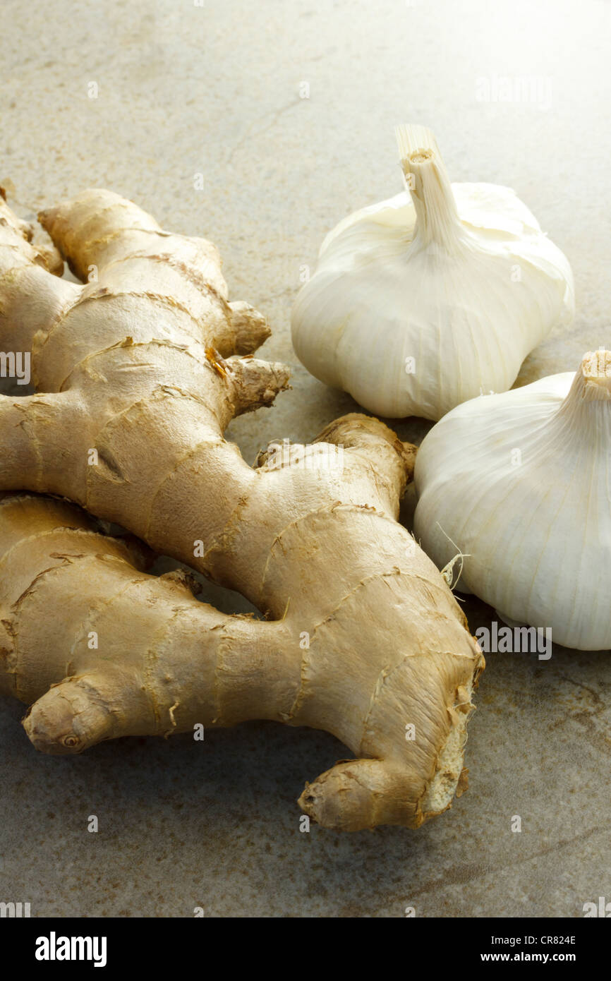 Ginger and garlic on the stone table - Stock Image