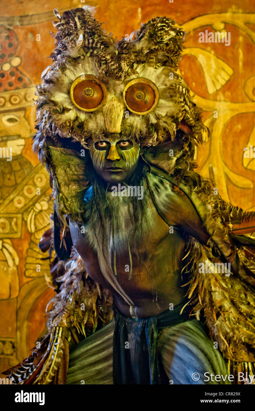 A Maya Dancer/Actor Buho (Owl) in costume performing a Mayan Ritual at Xcaret Park, Riviera Maya, Mexico - Stock Image