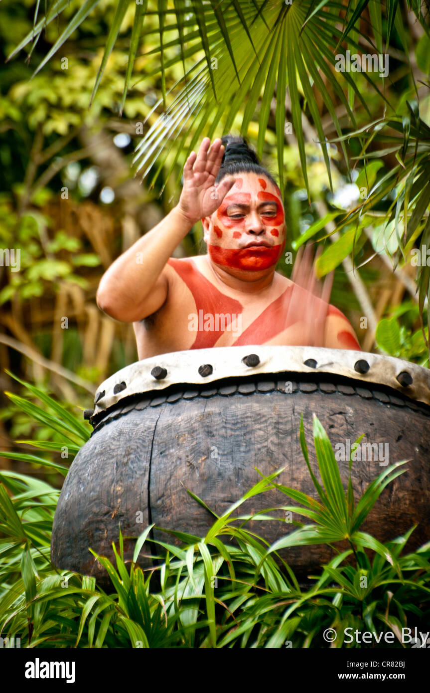 A Maya fokllore ritual is performed by a  drum performer at Xcaret Park, Riviera Maya, Quintana Roo, Mexico - Stock Image