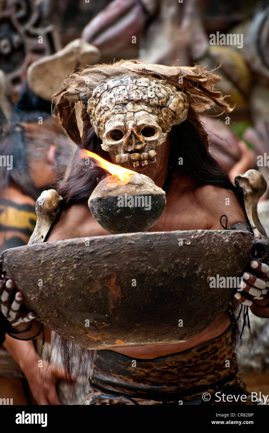 A Maya fokllore fire dance ritual is performed by a mystical performer in Xcaret Show, Playa Del Carmen, Quintana - Stock Image