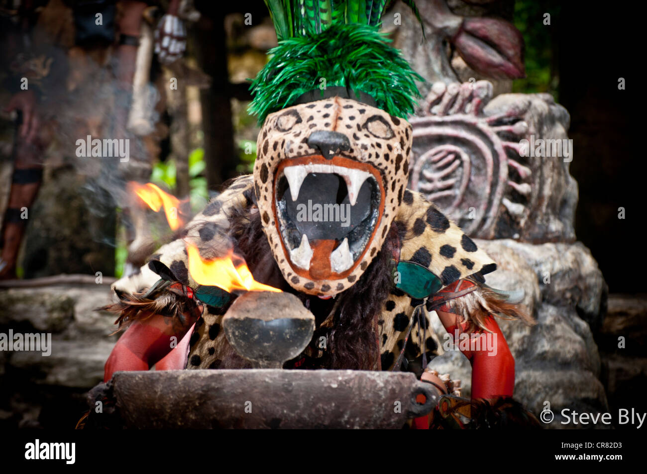 A Maya fokllore fire dance ritual is performed by a mystical performer in Xcaret Show, Riviera Maya,, Quintana Roo, - Stock Image