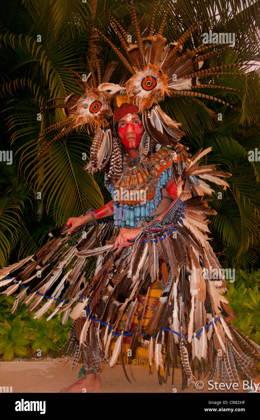 A Mayan fokllore ritual is performed by a maya performer in traditional dress, Riviera Maya, Mexico - Stock Image