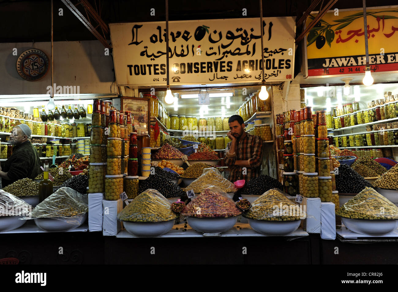 Stall with olives and preserved foods, Jemaa el-Fnaa square, UNESCO World Heritage Site, Marrakech, Morocco, Maghreb - Stock Image