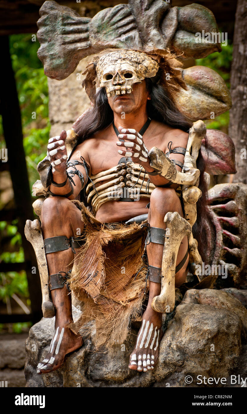 A Mayan fokllore ritual is performed by a Maya mystical performer in Xcaret Park, Riviera Maya, Mexico - Stock Image