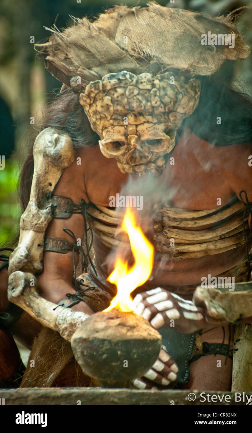 A Mayan fokllore fire ritual is performed by a Maya mystical performer at  Xcaret Park,  Riviera Maya, Mexico - Stock Image